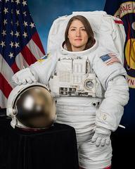 Christina Koch official portrait in an EMU - NASA/Bill Stafford