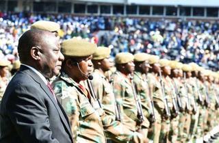 President Cyril Ramaphosa reviews members of the SANDF